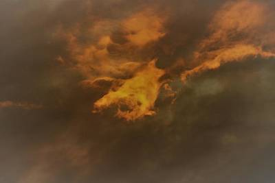Photograph - Faces In The Clouds by Karen Silvestri