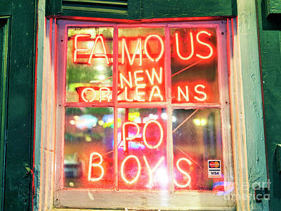 Photograph - Famous New Orleans Po Boys At Night by John Rizzuto