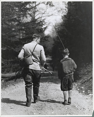 Photograph - Father And Son Strolling For Fishing In by Bettmann