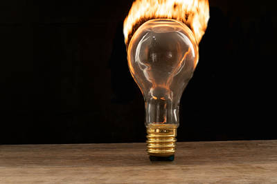 Photograph - Fire And Flames Ignited Out Of Light Bulb by Vincent Billotto