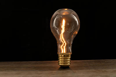 Photograph - Fire Sparks Inside A Light Bulb by Vincent Billotto