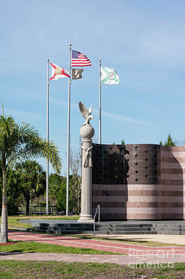 Photograph - Flags Fly At The Collier County Freedom Memorial At Freedom Park by William Kuta