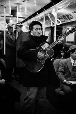 Photograph - Folk Singer Woody Guthrie Singing by Eric Schaal