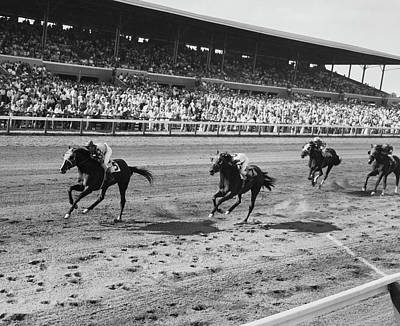 Photograph - Four Jockeys Riding Horses In A Race by Superstock