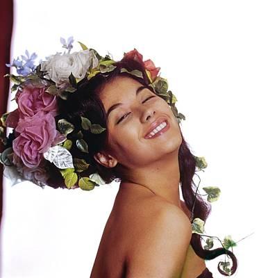 Photograph - France Nuyen In A Flower Headdress by Bert Stern