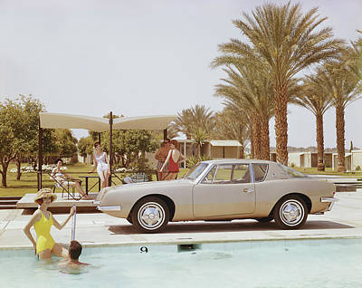 Holding Photograph - Friends Having Fun Near Pool by Tom Kelley Archive