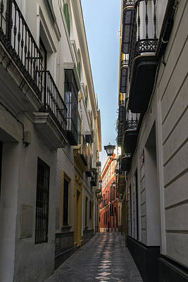 Photograph - Gallivanting Around Seville Is Pure Charm - Narrow Street Morning Glow by Georgia Mizuleva