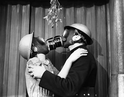 Photograph - Gas Mask Kiss by Fox Photos