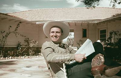 Photograph - Gene Autry Reads A Script by Michael Ochs Archives