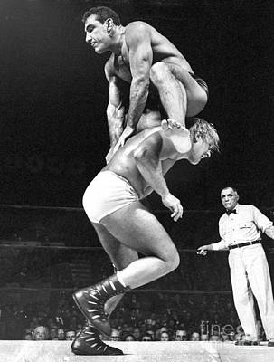 Photograph - Gene Stanlee Leaps Over Antonio Rocca by New York Daily News Archive