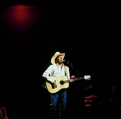 Photograph - George Strait Perfoms On Stage by David Redfern