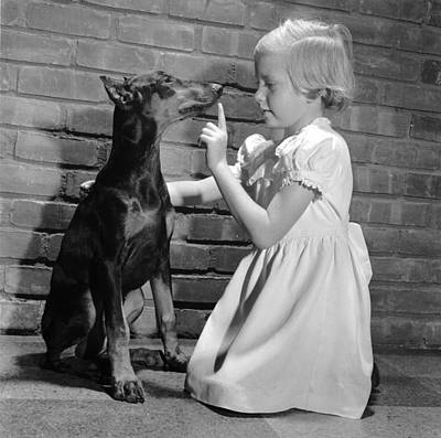 Doberman Pinscher Wall Art - Photograph - Girl Meets Dog by Three Lions