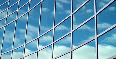 Photograph - Glass Building Reflecting Blue Skies by Michelangeloboy