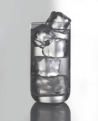 Glass Filled With Water And Ice Art Print by Tom Kelley