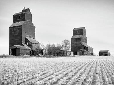 Photograph - Grain Elevators Winter Prairie by Dominic Piperata