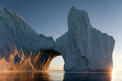 Sunlight Photograph - Greenland, Ilulissat, Arched Iceberg by Paul Souders