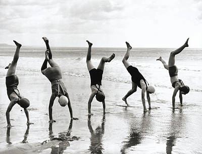 Clothing Photograph - Group Of People Doing Handstands On by Hulton Archive