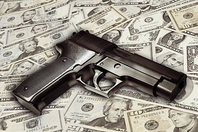Photograph - Gun On Cash by Les Cunliffe