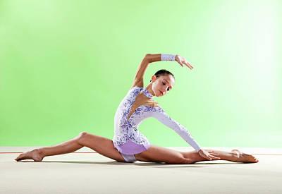 Hand Photograph - Gymnast, Split Floor Looking Back by Emma Innocenti