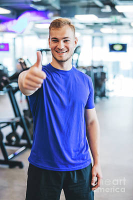 Photograph - Happy Man Standing At The Gym, Showing Thumb Up. by Michal Bednarek