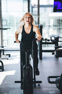 Photograph - Happy Woman Riding An Air Bike At The Gym. by Michal Bednarek