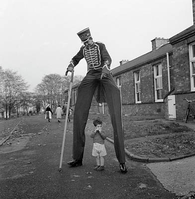 Walking Photograph - Henry The Stilt Man by John Drysdale