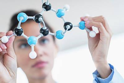 Hispanic Scientist Examining Molecular Art Print by Jgi/tom Grill