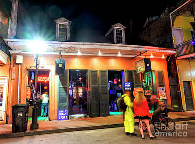 Photograph - Holding Court On Bourbon Street At Night In New Orleans by John Rizzuto