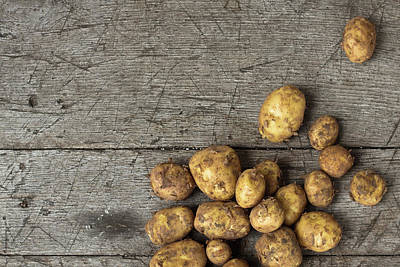 Photograph - Homegrown Potatoes On An Old Wood Table by Infrontphoto