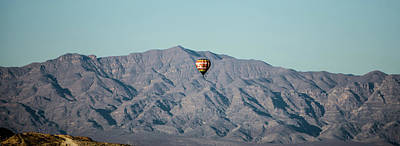 Photograph - Hot Air Balloon Flying Above Red Rock Canyon by Alex Grichenko