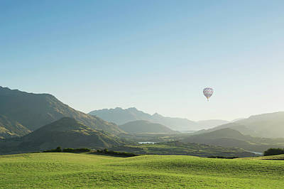 Photograph - Hot Air Balloon Flying Above Rolling by Jacobs Stock Photography Ltd