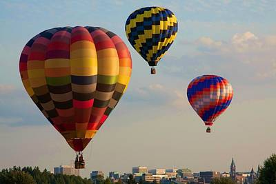 Photograph - Hot Air Balloons Flying Over The City by Tatiana Travelways