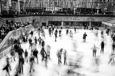 Photograph - Ice Skaters On The Rink New York City by John Rizzuto