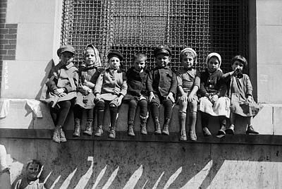 Photograph - Immigrant Children Sitting On Window by Bettmann