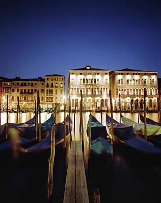 Photograph - Italy, Veneto, Venice, Row Of Gondolas by Gary Yeowell