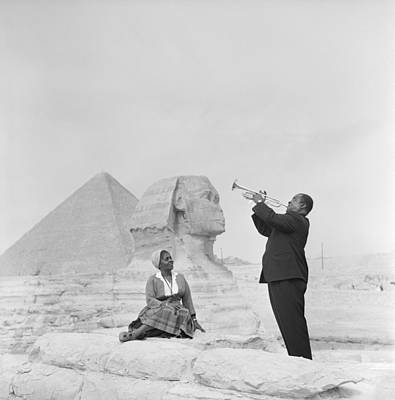 Sitting Photograph - Jazz Trumpeter Louis Armstrong Playing by Bettmann