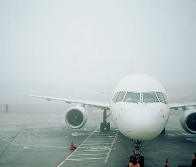 Photograph - Jet Aircraft On Tarmac In Storm by Andy Ryan