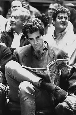 Photograph - John F. Kennedy Jr. Peruses The Daily by New York Daily News Archive