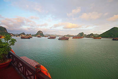 Junk Boat Wall Art - Photograph - Junk Boats At Sunrise In Halong Bay by Matt Champlin
