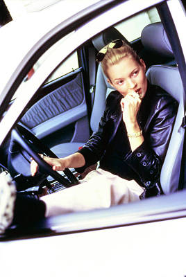 Photograph - Kate Moss Sits At The Wheel Of A Car by Arthur Elgort