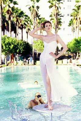 Photograph - Kristen Mcmenamy Wearing A White Dress By A Pool by Arthur Elgort