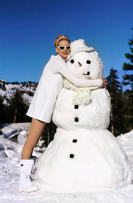 Winter Trees Photograph - Krister Mcmenamy Wearing White By A Snowman by Arthur Elgort