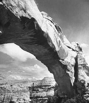Photograph - Large Rock Formation Forming A Bridge Ac by Loomis Dean