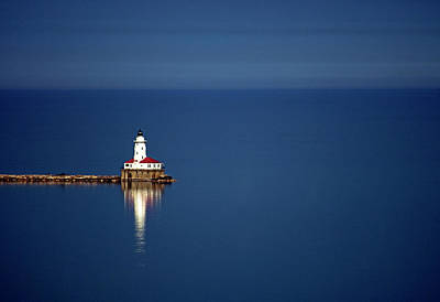 Lighthouse On A Lake Art Print by By Ken Ilio