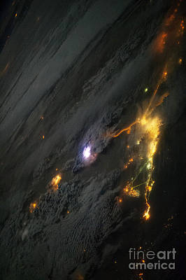 Photograph - Lightning From Space by NASA Johnson Space Center