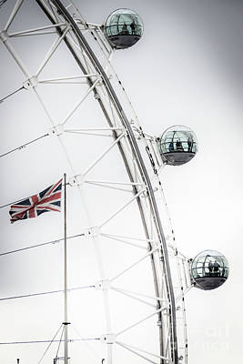Photograph - London Eye And Union Jack by Arnaldo Tarsetti