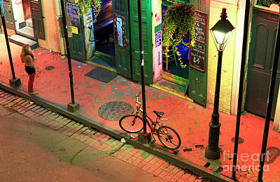Photograph - Lonely Bike On Bourbon Street At Night New Orleans by John Rizzuto
