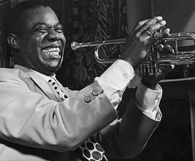 Photograph - Louis Armstrong Holding Trumpet by Bettmann