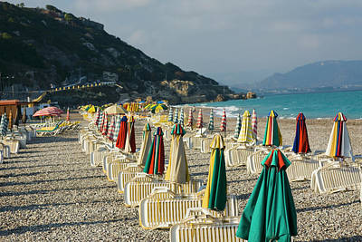 Lounge Chair Photograph - Lounge Chairs And Beach Umbrellas On by Glowimages