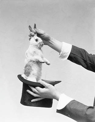 Magician Pulling Rabbit Out Of Hat Art Print by H. Armstrong Roberts